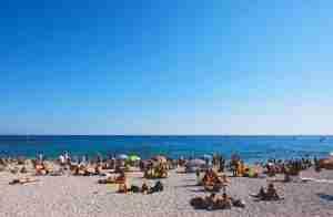 tourists beach pixabay 518975493
